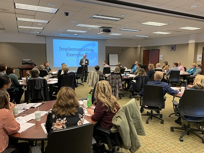 Healthcare professionals from across the state listen attentively during the inaugural implementation influencer bootcamp.